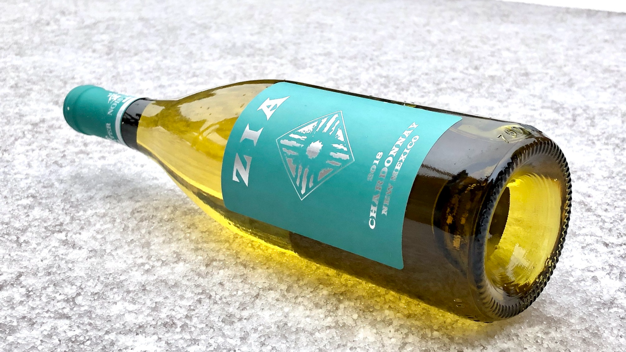 Noisy Water Winery's 2018 Zia Chardonnay on a bed of snow